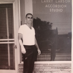 Larry standing in front of his music store when it was an accordion studio