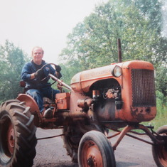 Larry on a tractor in Michigan