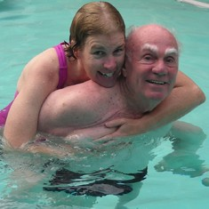 Leigh and Larry having fun in their pool.
