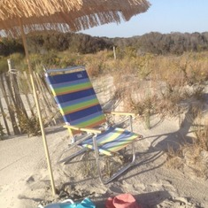 Mom's beach chair and beach umbrella.