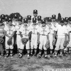 Dad on his little league team (he's the one third from left with his eyes closed)