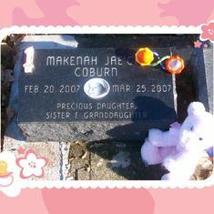 Makenah's headstone and toys