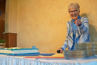 Marolyn cutting the cake at her 90th birthday party at Adair Village north of Corvallis. Nearly 100 people attended the event.