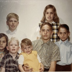 Michael the oldest of seven children shown in age order Nancy, Susie, Allen, Paul, David, and Karl