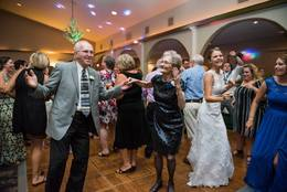 Nancy and Dan Pollnow light up the dance floor at the Mary and Dillon Leisure wedding.