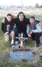 Niko's best friend Big Red w boys at graveside.