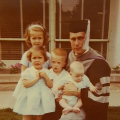 Dad graduating from Veterinary school. Rosanne, Denise, Paul, and David.