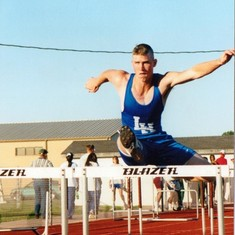 phillip jumping hurdle in high school