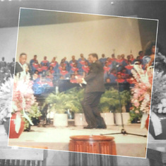 Rev Paul singing with the Mass Choirs