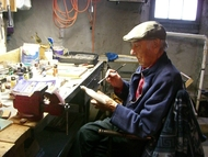 This is Dad in his basement workshop where he made wood carvings & paintings.  Some of his work can be seen on his daughter's website: colleenhammondart.com