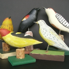 This is a nice group shot of some of dad's bird carvings. These were all done by hand and either painted with acrylics or colored pencils and sometimes both on one piece.