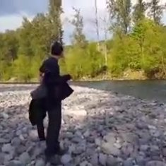 russ throwin rocks at the river