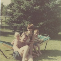 On the hammock in Minnesota, 1968.  My father set the timer then rushed to pose for the picture.