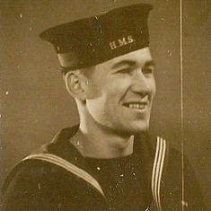 Charles in the Royal Fleet Auxillary uniform. This was the period when he was involved in a wartime project called PLUTO; Pipe Laying Under The Ocean.