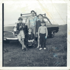 Charles's five children stand next to his old Ford Consul which we all used to pile into, the record stood at 11 people!