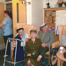 This photo is in Picton Court Nursing Home, Porthcawl. Beatrice was here for 6 months. They are photographed with a Vera Lynn impressionist who goes around the homes singing the old time favourites.