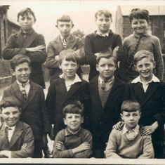 Charles, centre left, having a class photo taken in Coedpenmaen Primary School, Pontypridd. circa 1930