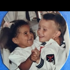 His first girlfriend Brianna we lived in Guam as we were a military family and he was the ring barer for Brianna's moms wedding. He was so cute in his Navy whites