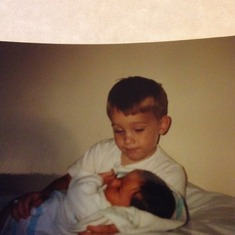 First time holding his baby sister he was/is such an amazing big brother he continues to look out for her always