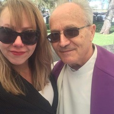 Charlena and the priest from Croatia who officiated at Sime's furneral service.