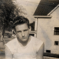 Tom next to home at 738 University Ave., 1946 (age 15)
