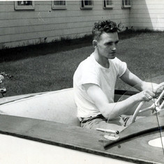 1950 - Tom and the boat he built