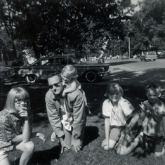 Tom with Peggy, Patty Rose, Colleen and Kevin, waiting for a parade on July 4, 1965