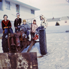 The kids loved to play on Tom's tractors (Jan. 1965)