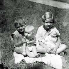 Tom with Cathy, Pat with doll she won in a beauty contest, 1934c