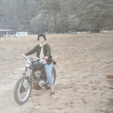 A glimpse of Trudy's wild side; riding a motorcycle circa mid 1950's