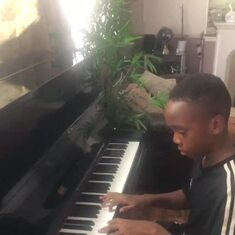 One of the Grandchildren practicing on the piano