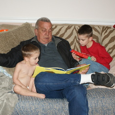 Dad reading to his grandkids Caden and Caleb thanksgiving 2009